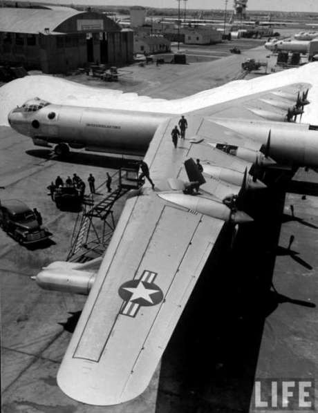 sacs-b-36-bomber-plane-getting-a-thorough-going-over-by-maintenance-mechanics-on-airstrip-outside-hangars-at-strategic-air-commands-carswell-air-force-base