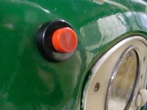 Botão de acionamento instalado no painel