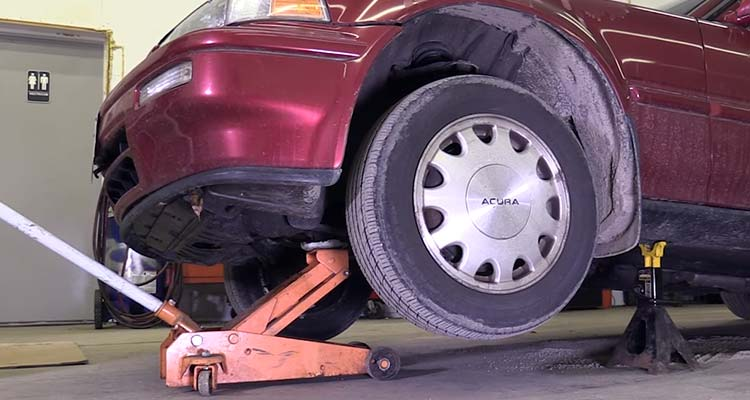 How To Lift A Vehicle And Support It Using Floor Jacks 5