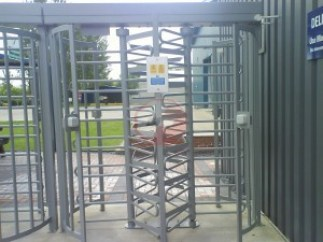 Full height dual lane three arm turnstile