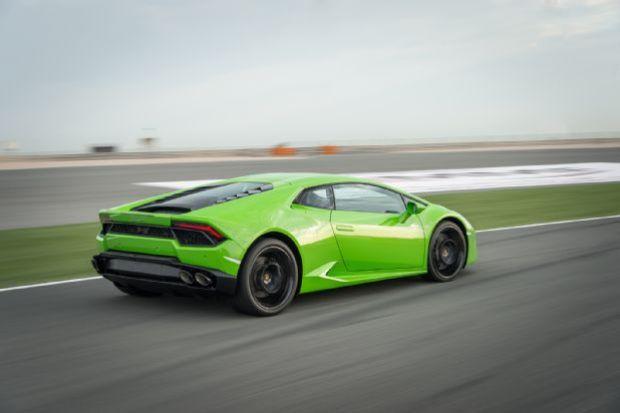 2016 Lamborghini Huracan LP580 2 Rear Three Quarter In Motion 09