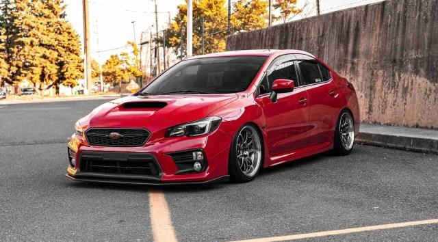 red subaru show car at a car meet-up