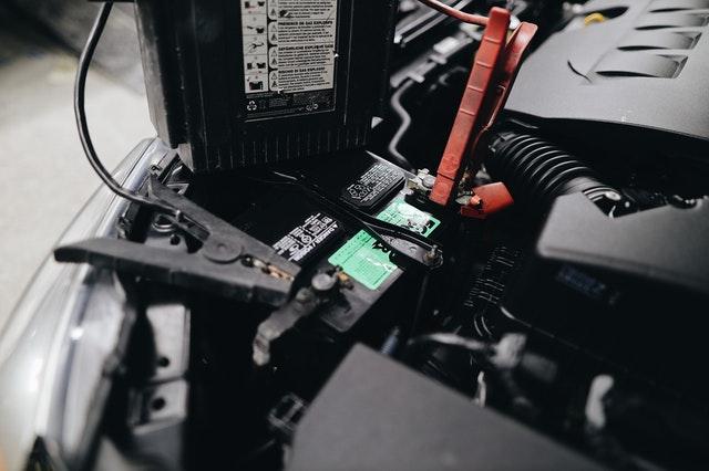 Spark plugs on a car battery.