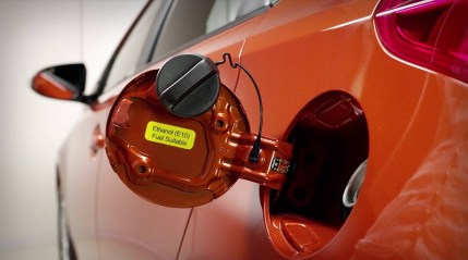 Remove gas cap to help relieve fuel pressure.