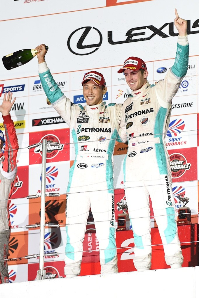 SUZUKA, JAPAN - AUGUST 31:  Kazuki Nakajima (L) and James Rossiter (R). of LEXUS TEAM PETRONAS TOM'S celebrate on the poduim after winning the race during the 2014 AUTOBACS GT Round 6 43rd International 1000km GT500 - Final Race at Suzuka Circuit on August 31, 2014 in Suzuka, Japan.  (Photo by Atsushi Tomura/Getty Images for MOBILITYLAND)