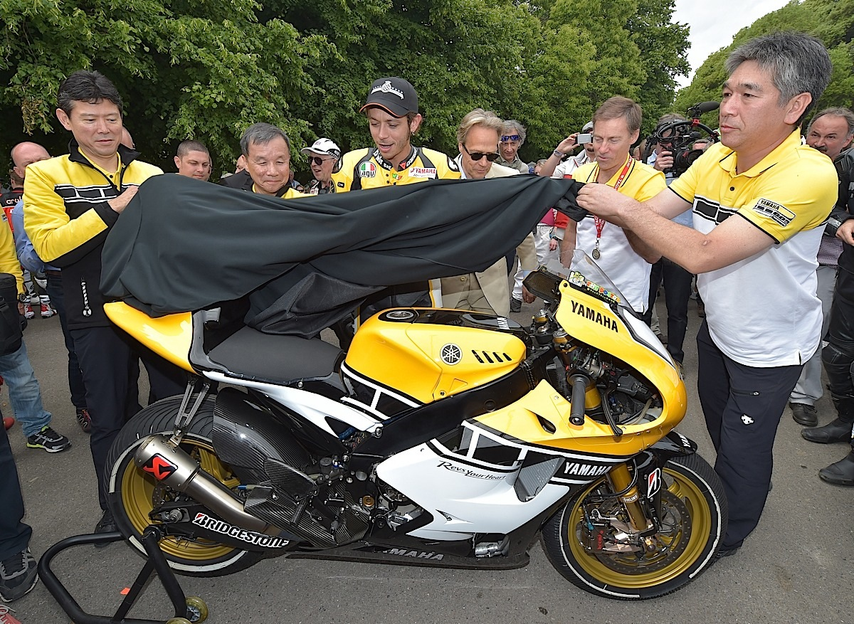 CHICHESTER, ENGLAND - JUNE 28:  Valentino Rossi (C) unveils the Yamaha 60th anniversary bike alongside Yamaha officials Kouichi Tsuji (L), Takaaki Kimura (2nd L), Lin Jarvis (2nd R), Kazuhiro Kuwata (R) and Lord March (3rd R) during the Festival of Speed on June 28, 2015 in Chichester, England.  (Photo by Charles McQuillan/Getty Images for Yamaha Motor Co., LTD)