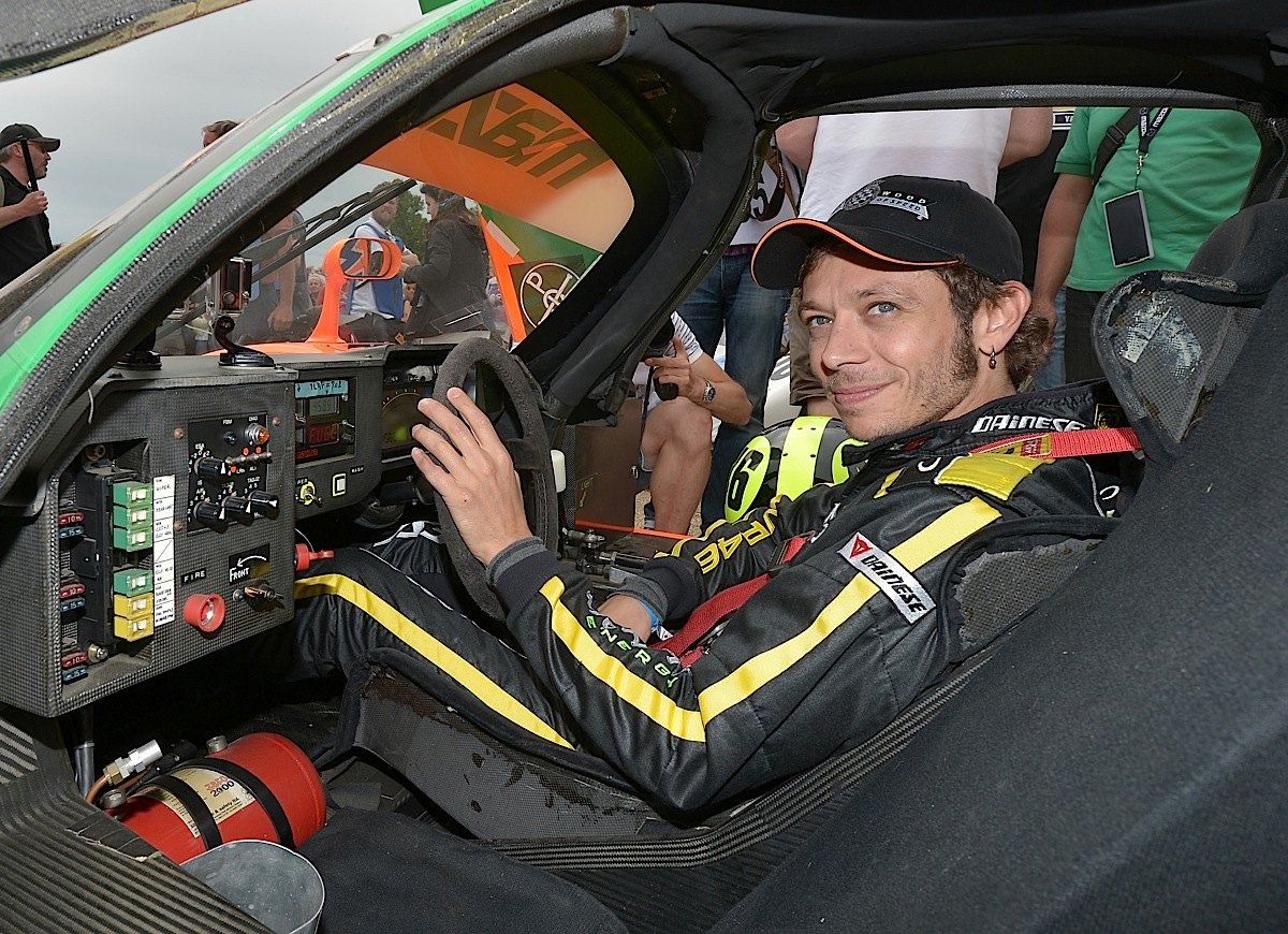 CHICHESTER, ENGLAND - JUNE 28:  Valentino Rossi prepares to take part in the famous Hill Climb driving a Mazda during the Festival of Speed on June 28, 2015 in Chichester, England.  (Photo by Charles McQuillan/Getty Images for Yamaha Motor Co., LTD)