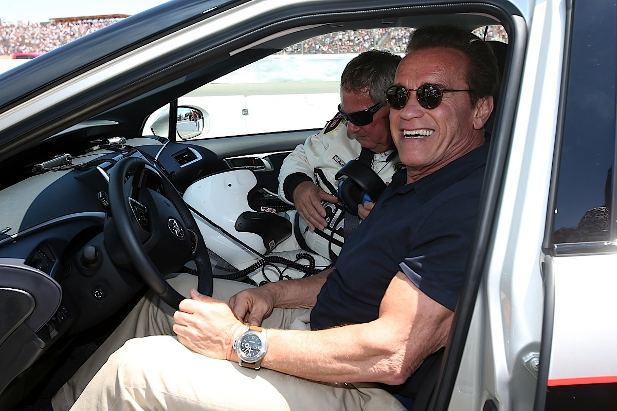 SONOMA, CA - JUNE 28:  Actor and former governor of California Arnold Schwarzenegger poses for a photo before driving the 2016 Toyota Mirai pace car, a hydrogen fuel-cell electric vehicle, on pit road prior to the NASCAR Sprint Cup Series Toyota/Save Mart 350 at Sonoma Raceway on June 28, 2015 in Sonoma, California.  (Photo by Chris Graythen/Getty Images) *** Local Caption *** Arnold Schwarzenegger