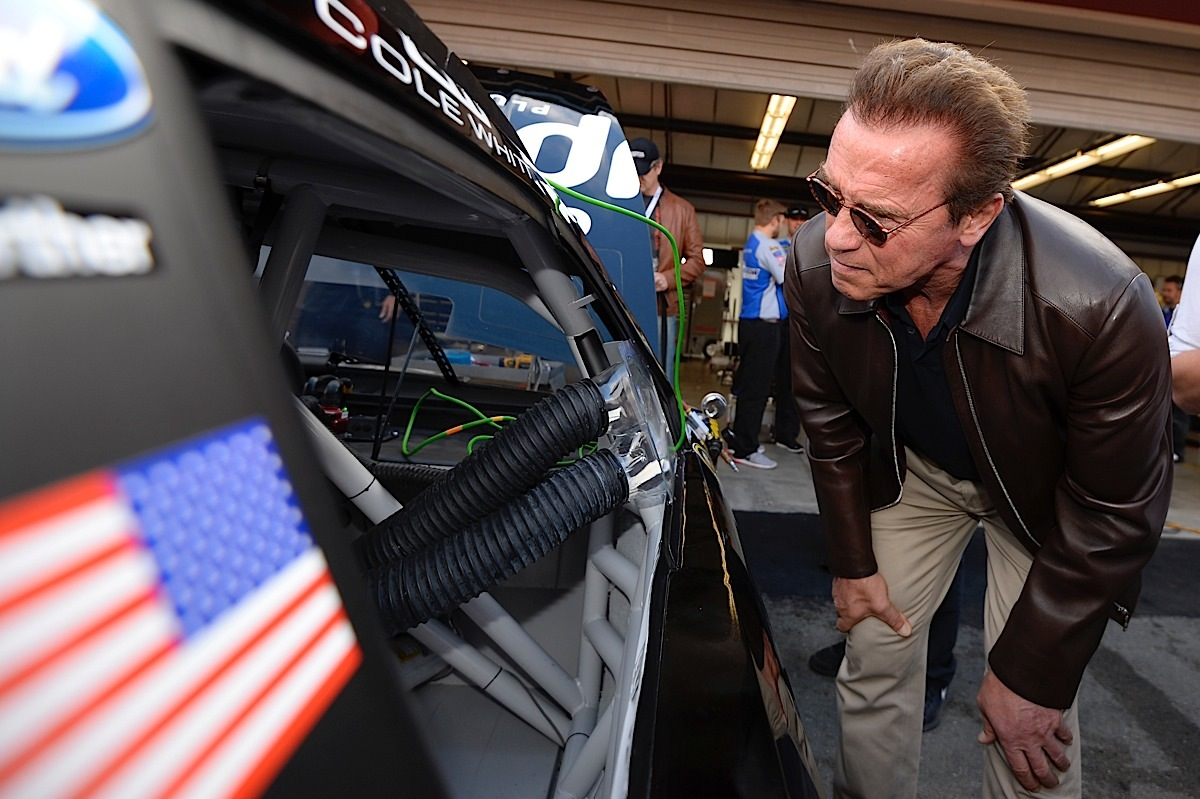 SONOMA, CA - JUNE 28:  Actor and former governor of California Arnold Schwarzenegger looks into a car prior to the NASCAR Sprint Cup Series Toyota/Save Mart 350 at Sonoma Raceway on June 28, 2015 in Sonoma, California.  (Photo by Robert Laberge/Getty Images) *** Local Caption *** Arnold Schwarzenegger