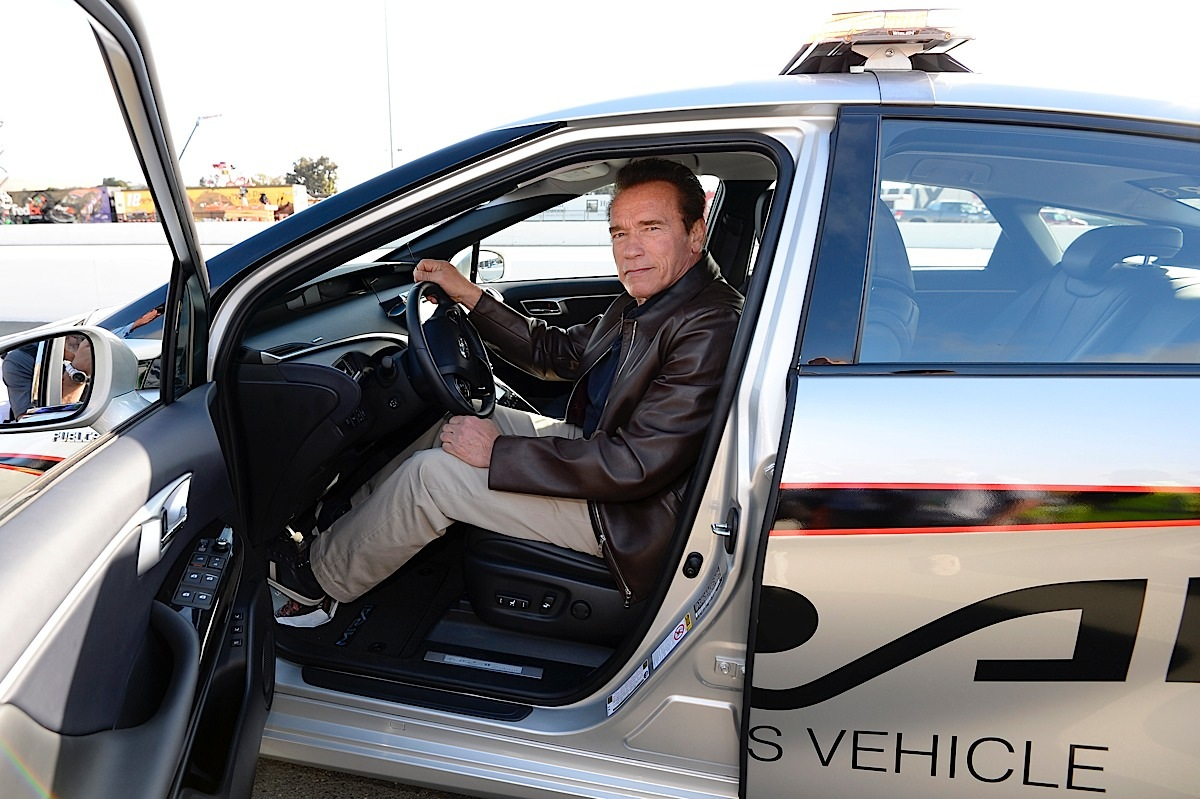 SONOMA, CA - JUNE 28:  Actor and former governor of California Arnold Schwarzenegger poses in the 2016 Toyota Mirai pace car, a hydrogen fuel-cell electric vehicle, on pit road prior to the NASCAR Sprint Cup Series Toyota/Save Mart 350 at Sonoma Raceway on June 28, 2015 in Sonoma, California.  (Photo by Robert Laberge/Getty Images) *** Local Caption *** Arnold Schwarzenegger