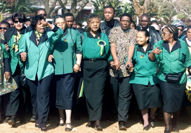 WINNIE MADIKIZELA MANDELA LEADS A MARCH DURING A WOMAN'S DAY RALLY.