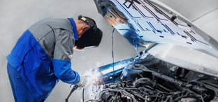 Man working on a vehicle