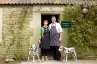 The Pear Tree Inn's new custodians - landlord Jackie Cosens and chef Adrian Jenkins, with their dalmatians