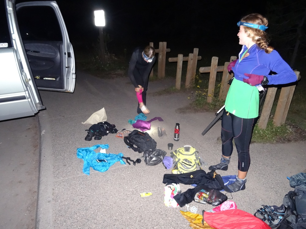 The girls change out of their biking clothes and get ready to hike the 3 miles to the start of the swim across Leigh lake.