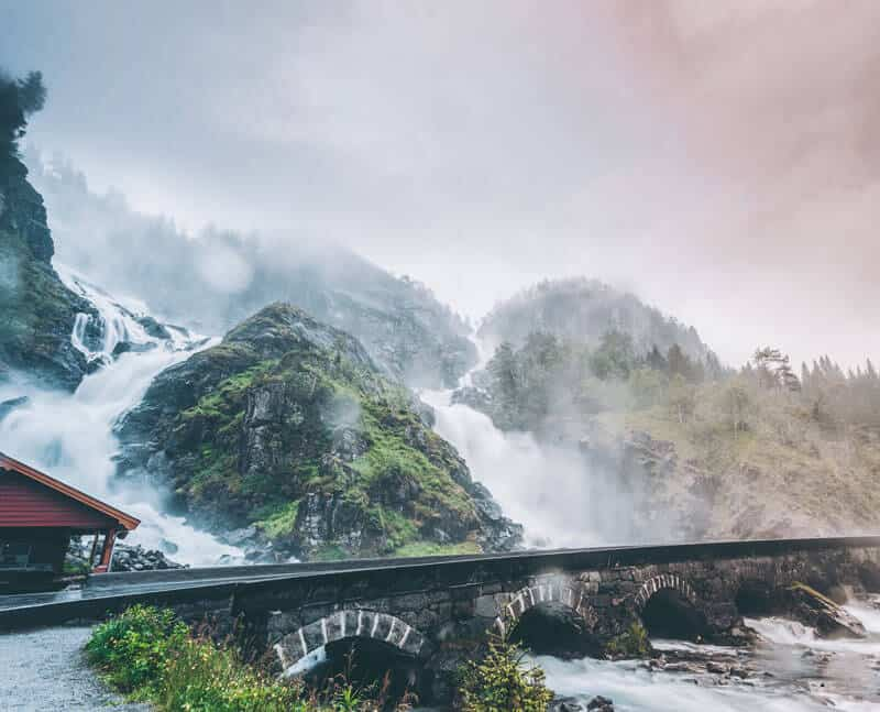 Powerful twin waterfall Latefoss or Latefossen and six arched bridge along Route 13 Odda Hordaland County in Norway.
