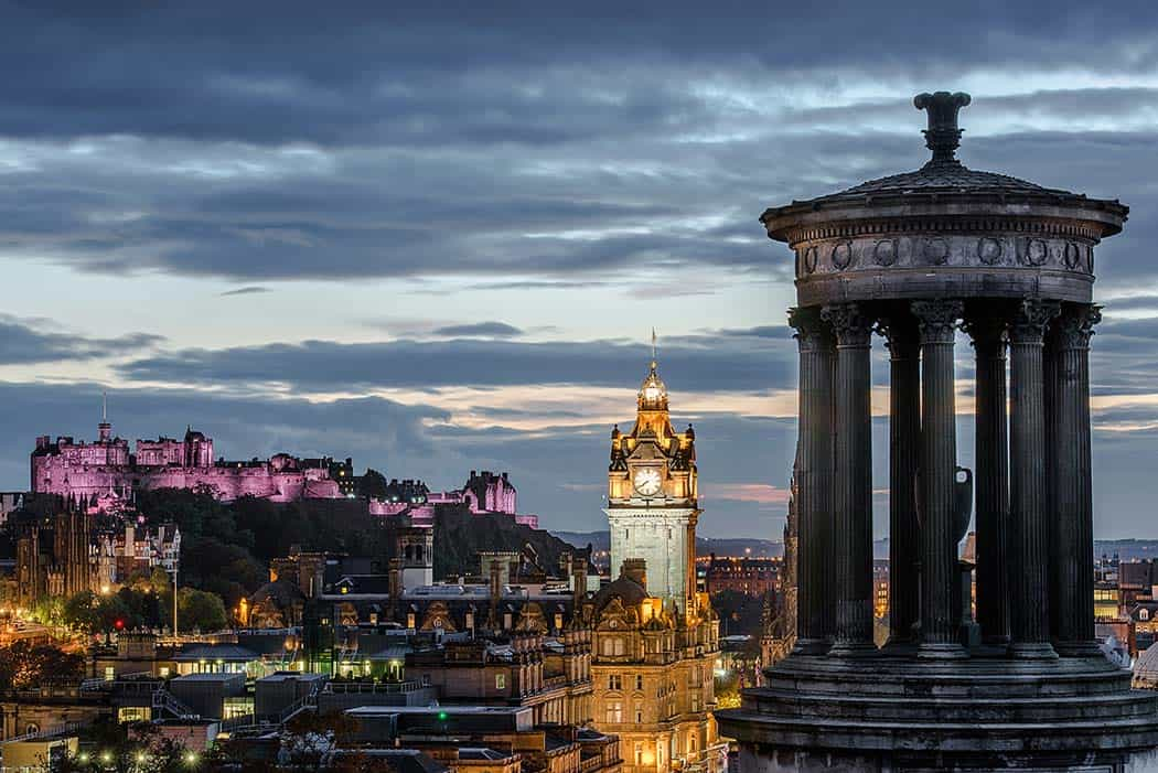 Edinburgh castle (purple lights) and the cityscape at night. Click through to see 28 mind blowing photos of Scotland!