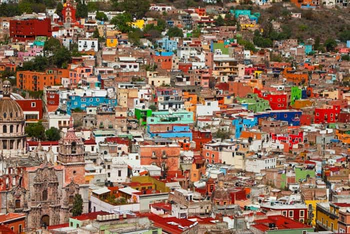 Guanajuato, Mexico! Click through to see some of the most colorful cities in the world! This post does not contain industrial soot stained cities; instead it showcases some of the most vibrant looking cities in the world.