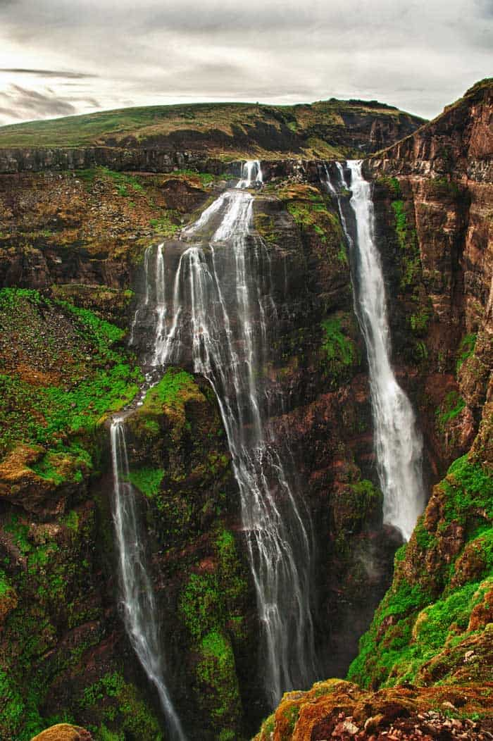 Glymur is Iceland's tallest waterfall coming in at a whopping 650 feet (198 meters). It is not visible from the road so you will need to hike there. Click through to see 15 of Iceland's most amazing waterfalls!