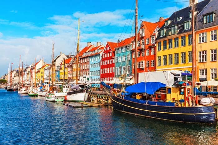 Nyhavn, Copenhagen, Denmark! Click through to see some of the most colorful cities in the world! This post does not contain industrial soot stained cities; instead it showcases some of the most vibrant looking cities in the world.
