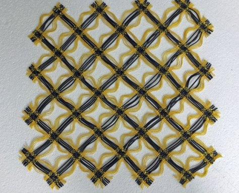 """Weefkunst """"Geel-zwart-rechthoekig' Linnen-rubber, 50x55 cm."""