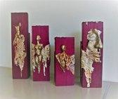 Purple-heart. Serie van 4 unieke beelden. Gegoten lood op purple heart. hoogte circa 32 cm.