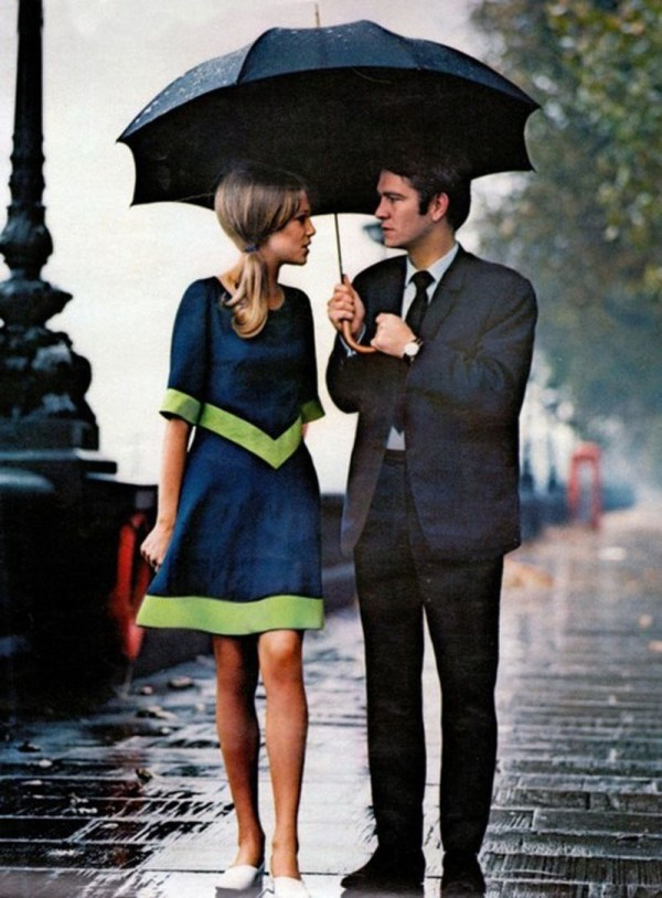 A stylish couple in the rain in London (1963)