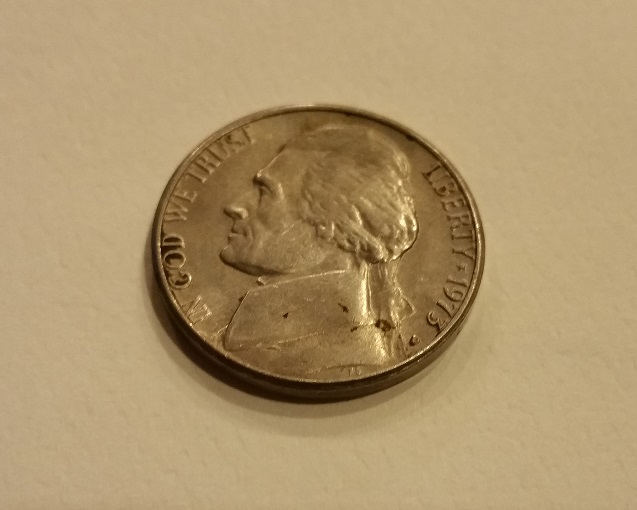 1973 Jefferson Nickel.  Placed by a a worker at the factory?  hmmmm....