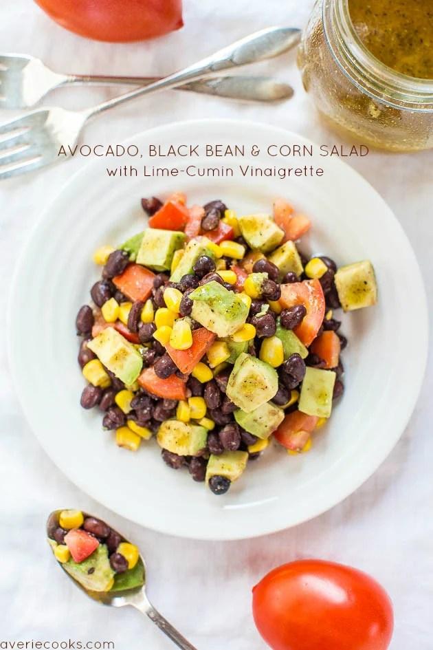 Black Bean Corn Avocado Salad with lime vinaigrette in a white bowl