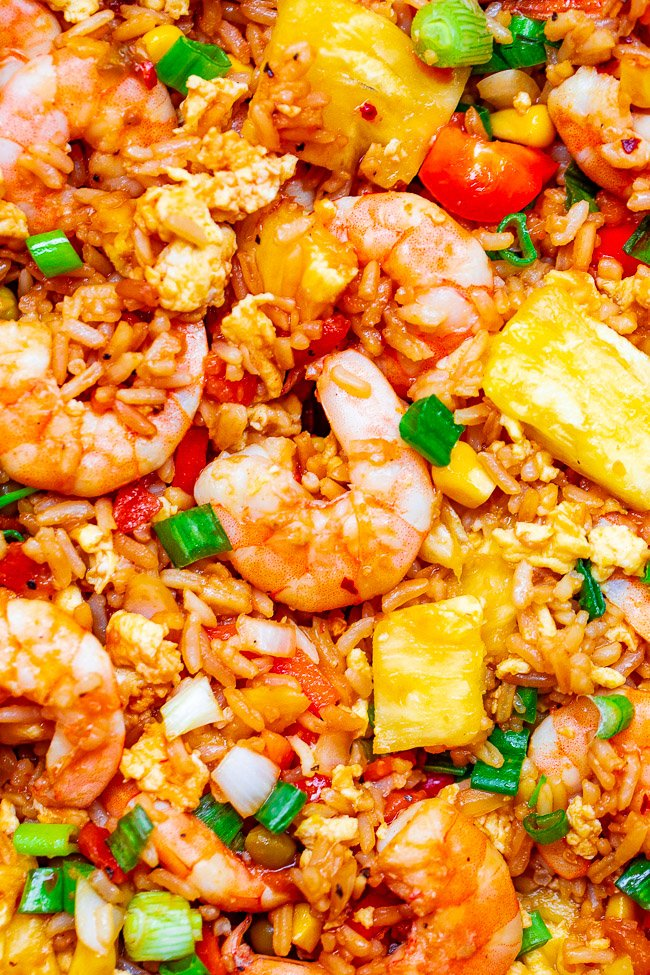 Pineapple Fried Rice - A Hawaiian-inspired shrimp fried rice recipe that's EASY, ready in minutes, and has so much authentic flavor!! A family favorite that's better-than-takeout!!