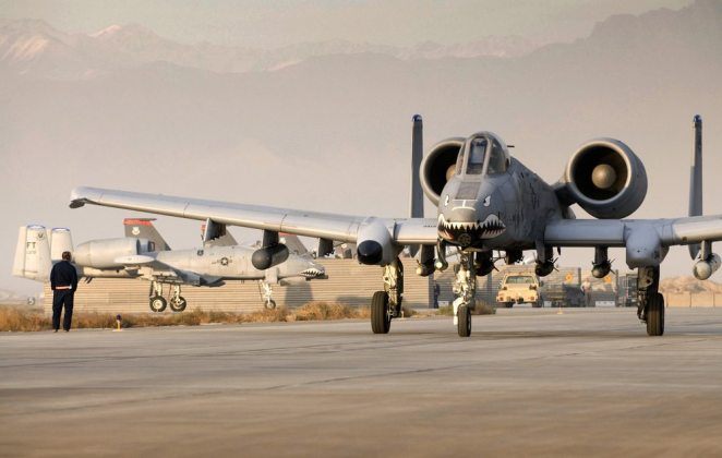 "An A-10 Thunderbolt II, piloted by Capt. Eric Fleming, prepares for takeoff at Bagram Air Field, Afghanistan, Dec. 2. The teeth painted on the nose of the aircraft symbolizes the legacy of the fighter squadron, dating back to the famous ""Flying Tigers"" of WWII. (U.S. Air Force photo by Staff Sgt. Samuel Morse)(Released)"