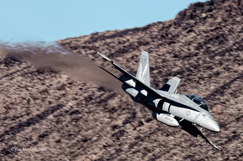 Hornet from VX-9 Vampires, China Lake, dives into the canyon to begin its low level.