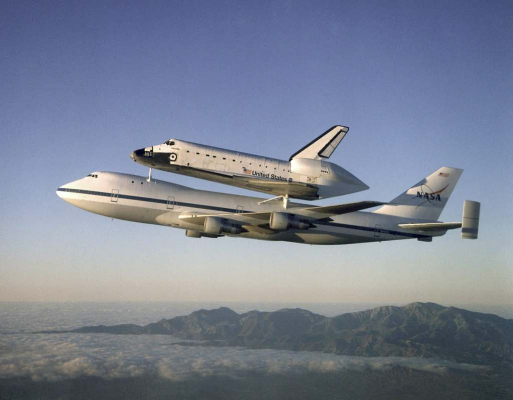 The Space Shuttle Atlantis is carried on the back of a 747. Credit: NASA