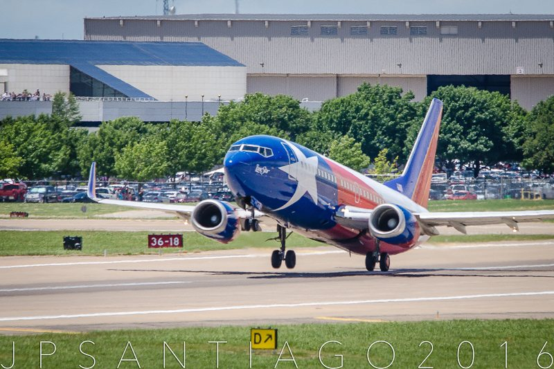 Lift off from 13R at Dallas Love Field. Note all the Southwest employees in the parking lot and open deck of the airline's headquarters building.