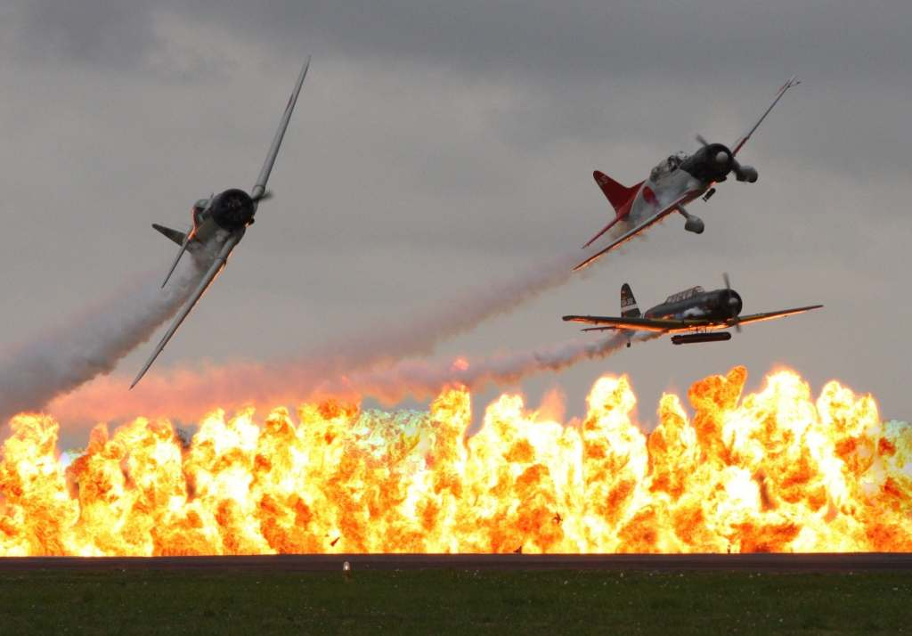 More details Tora! Tora! Tora! Gang flying a Zero, Val, and Kate, break over wall of fire created by the Tora Bomb Squad Ebdon - Own work Commemorative Air Force Gulf Coast Wing's Tora! Tora! Tora! Gang flying a Zero, Kate and Val, break over wall of fire created by the Tora Bomb Squad