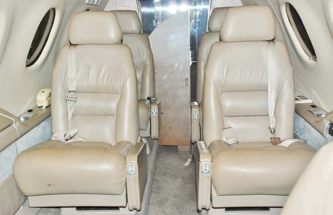 The cabin has six seats; the front two seats face aft. The Princess phone clearly dates the design.