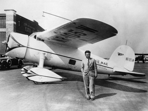 "Wiley Post and his Lockheed 5C Vega ""Winnie Mae"". Photo: Hulton Archive"