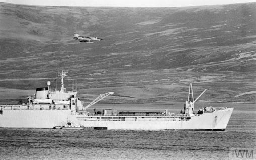 THE FALKLANDS CONFLICT, APRIL - JUNE 1982 (FKD 183) An Argentine IAI Dagger passes low over RFA SIR BEDIVERE in San Carlos Water on 24 May 1982. Copyright: © IWM. Original Source: http://www.iwm.org.uk/collections/item/object/205189468