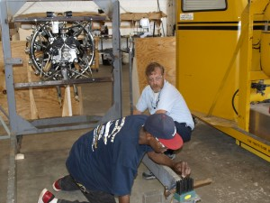 Cory Oglesby and instructor Kevin Patterson working on run stand