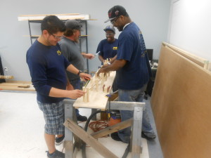 It takes a combined effort to work on a WWI Sopwith Pup