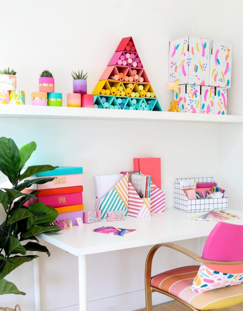 chair at desk with colourful accessories