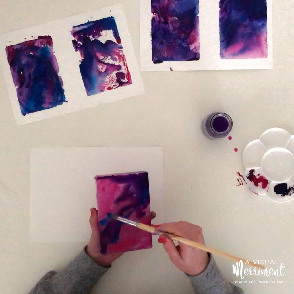 covering all of the acrylic block in paint with a paint brush