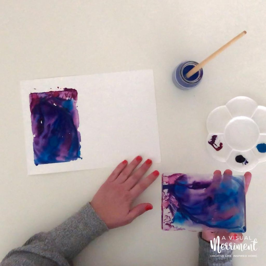 holding acrylic block over easy watercolour painting on paper