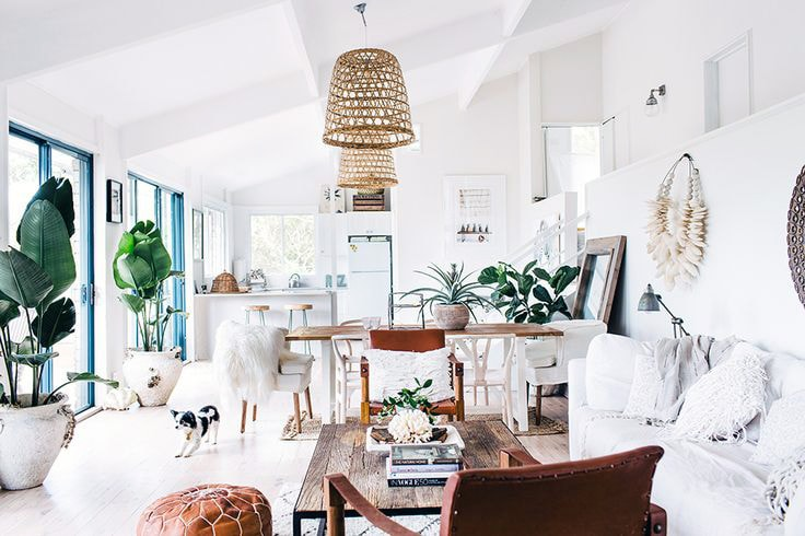 Relaxed coastal boho living room that includes plants