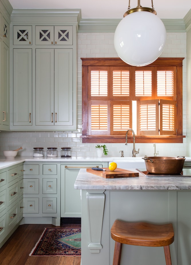 Sage green vintage modern farmhouse kitchen with subway tiles, timber and brass fixtures and tapware