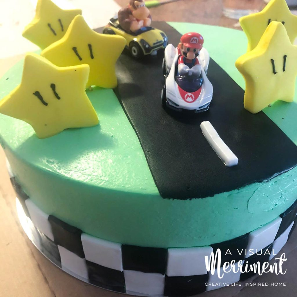 Simple Mario Bros cake with Donkey Kong and Mario race cars