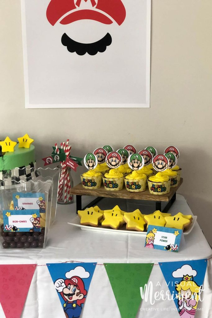 Mario and Luigi bunting and food table with cupcakes and treats