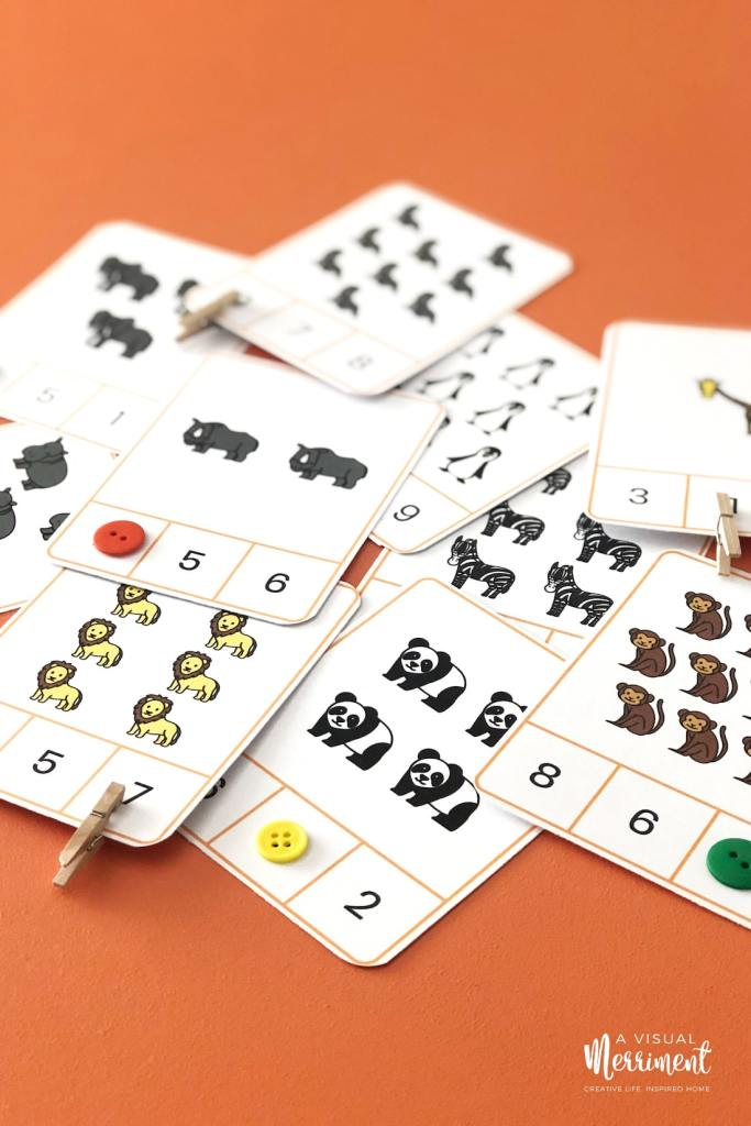 buttons and pegs on number cards