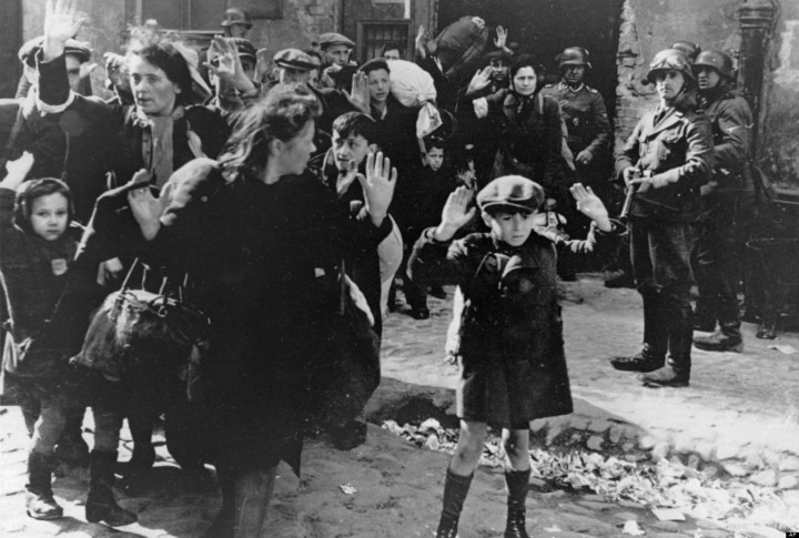 FILE- In this April 19, 1943 file photo, a group of Jews are escorted from the Warsaw Ghetto by German soldiers. (AP Photo/File)