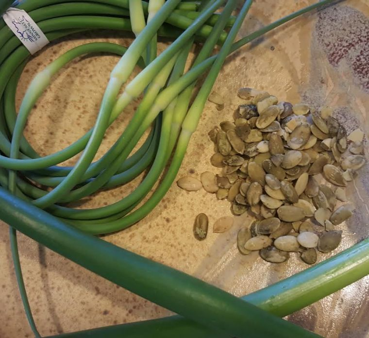Garlic scapes, onion scapes and raw pumpkin seeds