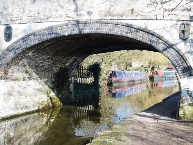 More boats under a bridge